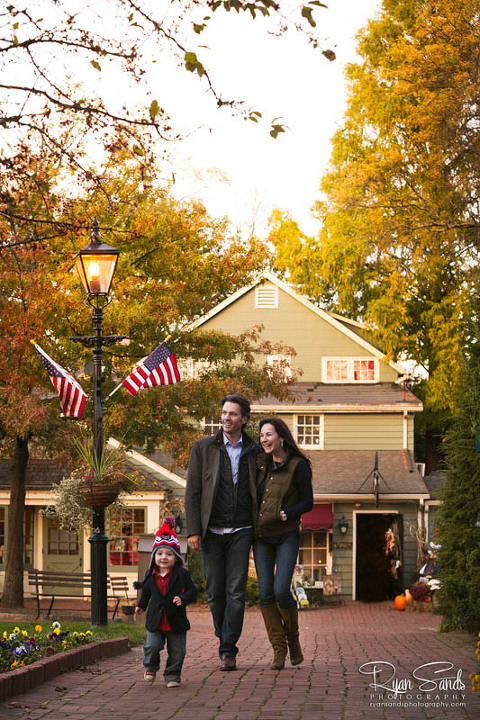 Peddler's Village Family Portrait Session - Here in Lahaska, PA it was a perfect fall day. Their child Ben runs in front as the parents walk hand in hand behind them through the streets of Peddler's Village.