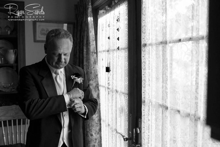 Gables Inn Wedding - Before heading off to be married Ed puts on his tux and straightens his cuffs.
