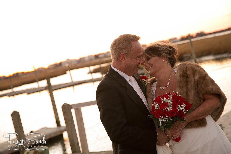 Gables Inn Wedding - After being married on a very chilly day in LBI the bride and groom hold each other to stay warm.