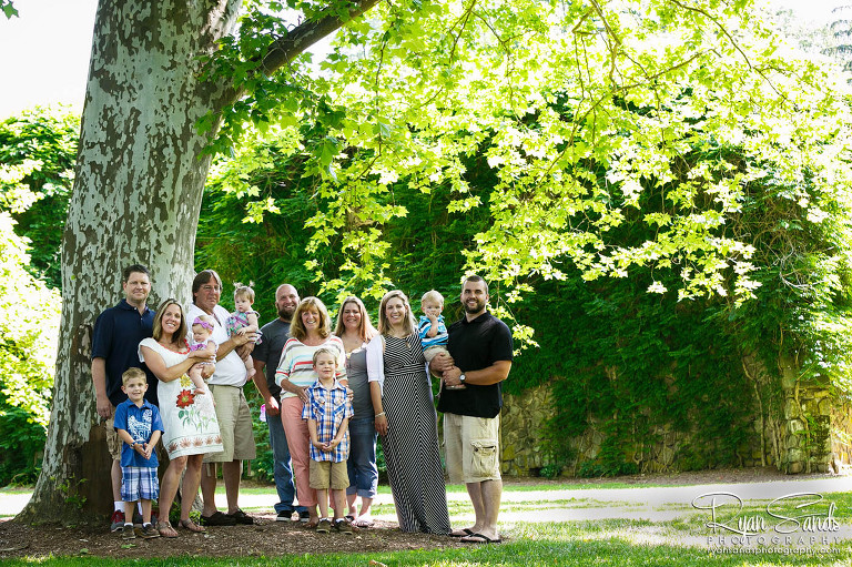 Somerset County Family Portrait Photographer - A beautiful family poses under a large tree at Duke Farms in Somerset, New Jersey.