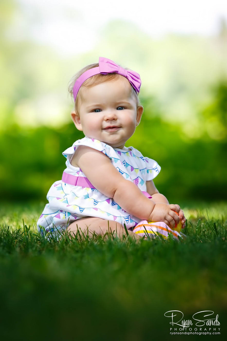 Somerset County Family Portrait Photographer - Here a cute baby sits on the grass at Duke Farms in Somerset, New Jersey.