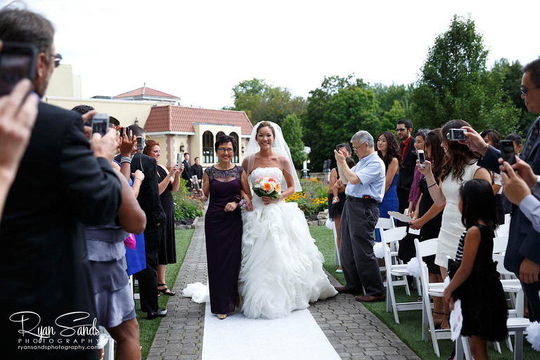 At her Villa Borghese wedding, Stephanie walks down the aisle towards her new husband.