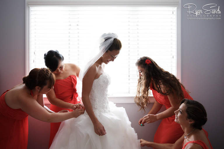 The bride gets ready with her bridesmaids on the morning of her wedding day.