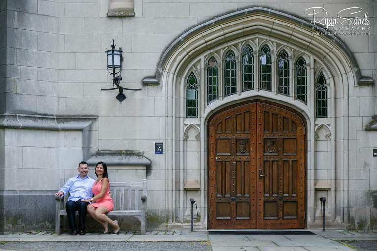 Princeton Engagement Session - On the Princeton University campus a beautiful couple sits together during a warm summer day.