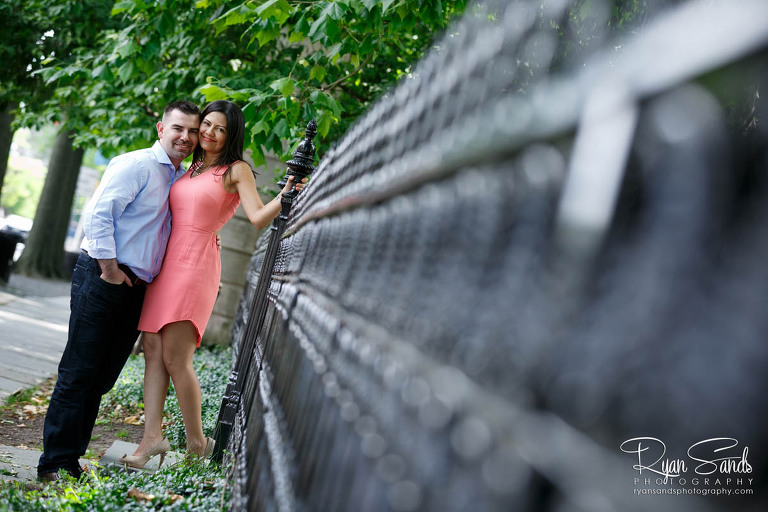 Princeton Engagement Session - Lina & Tim grab the iron gates of the university campus and pose for a cute engagement photo.