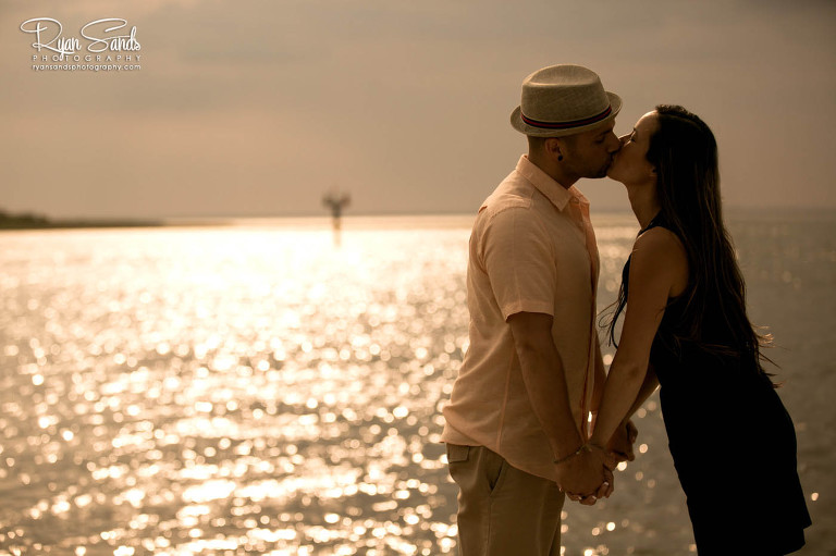 LBI Engagement Photographer - The engaged couple shares a kiss under the sun in LBI, New Jersey.