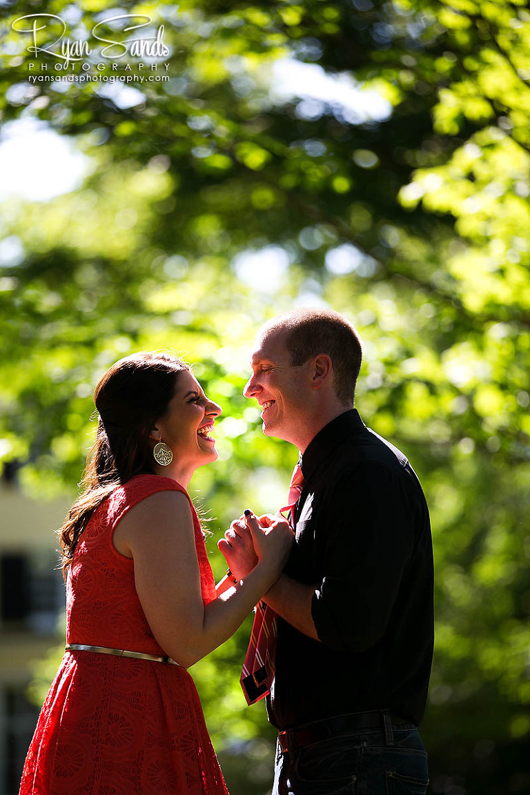 Princeton NJ Wedding Photographer - An engaged couple pose together on the Princeton University Campus.