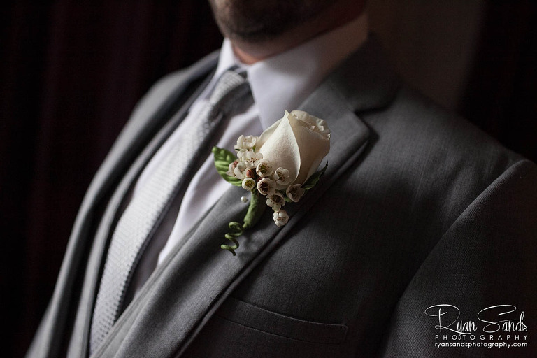 Grand Summit Hotel Wedding - A detail image of the groom with his flower pinned on his jacket.